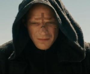 priest face cross